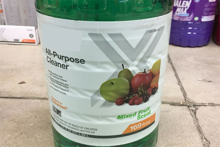 Household cleaner with fruit pictured on label.