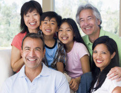 Multi-generational family in living room smiling