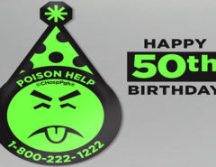 "An image containing Mr. Yuk with a birthday hat on and text saying ""Happy 50th Birthday"""