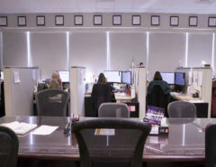 Wide angled photo of poison specialists working in the operations area of the Maryland Poison Center